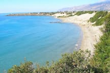 Orthi Ammos beach with clear blue sea and sandhills.