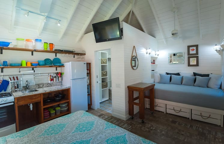 Arriba is an upstairs, king bed, and queen bed, poolside, studio condo