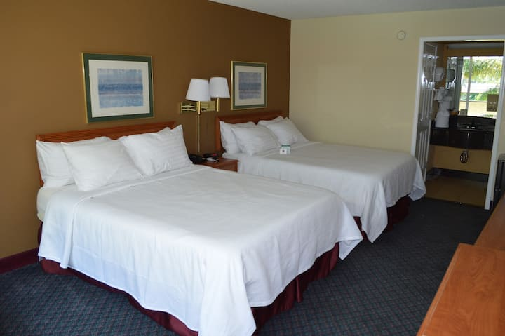 Deluxe Room with Two Queen size memory foam beds non-smoking. All rooms are independent from each other and enhanced sanitation is being implemented. We are open with some restrictions (breakfast is suspended and pool remains closed).