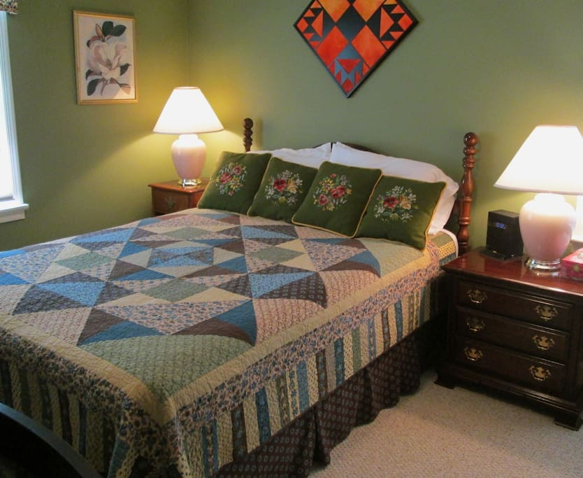 Enjoy and great night's sleep in the queen bed covered with a handmade quilt.