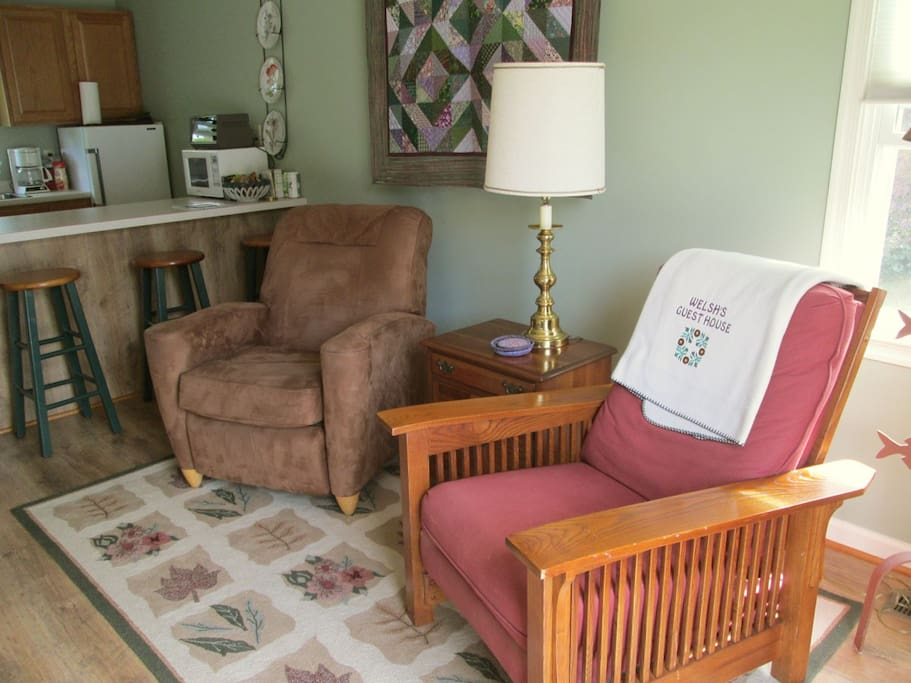 Two recliners make the lounge space even more cozy and comfy.