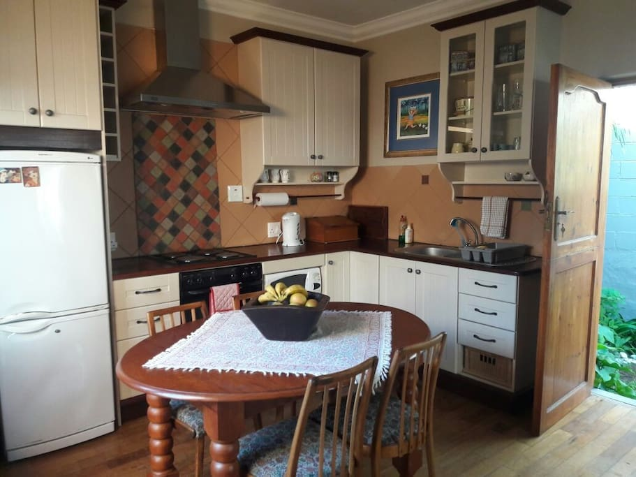 Open plan kitchen with stove, oven and microwave oven.