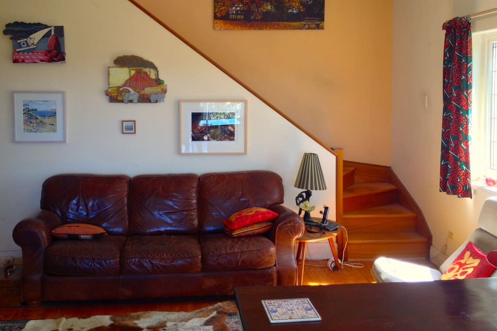 Sunny living room, with big tele.