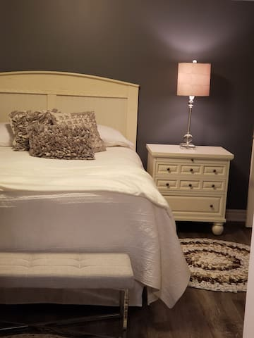 Queen size bed - with feather mattress pad