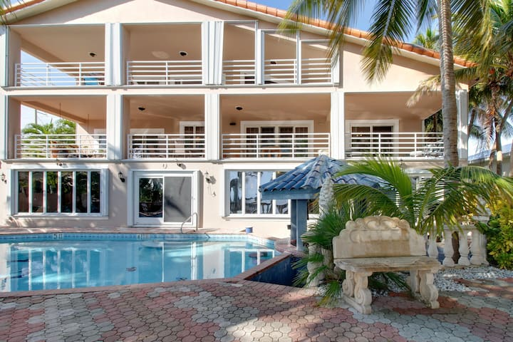 Mother-in-law condo in larger oceanfront estate w/ a shared pool, beach, & more!