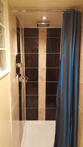 Private large shower enclosure. Soaps and Shampoo provided