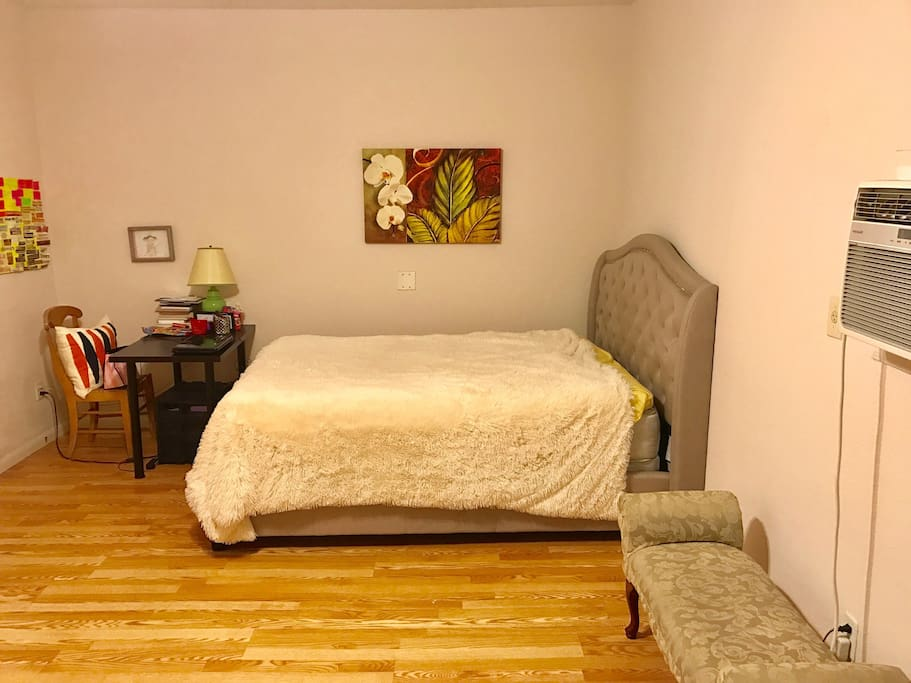 Bedroom from living room area. Queen size bed.