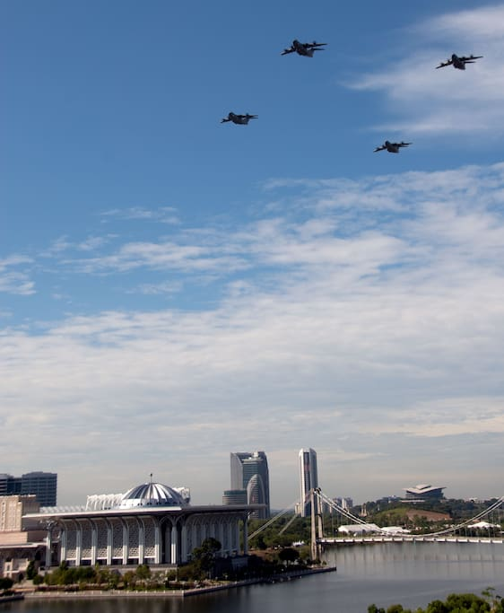 View from Cenic's balcony. National Day 2018 celebration with airplane fly through Putrajaya lake.