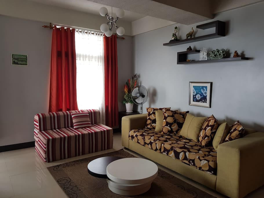 Living room area: - Couch - Sofa Bed - Electric Fan - Coffee Table