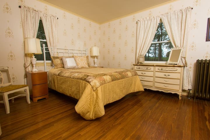 This is Room #1 which is on the first floor, has a queen bed, and its own bathroom