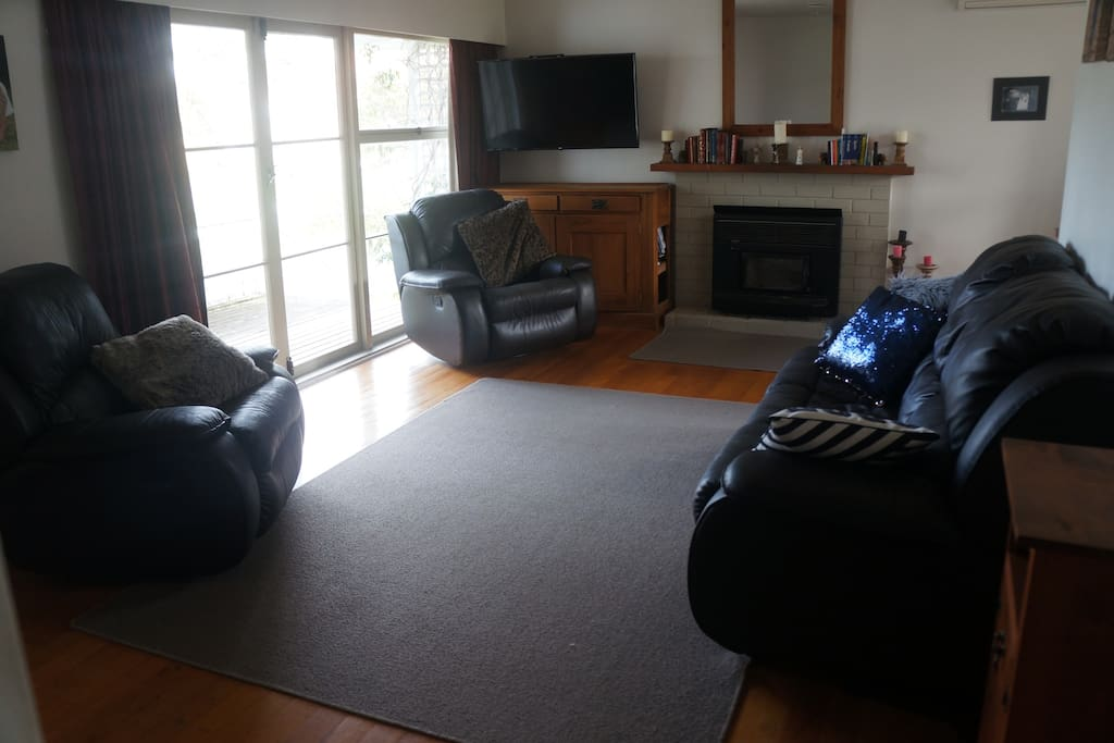 "Lounge with recliner chairs and 50"" smart TV with inbuilt netflix."