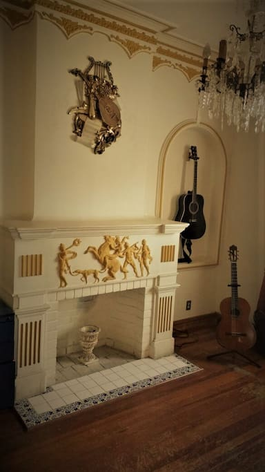 Fireplace and guitars.