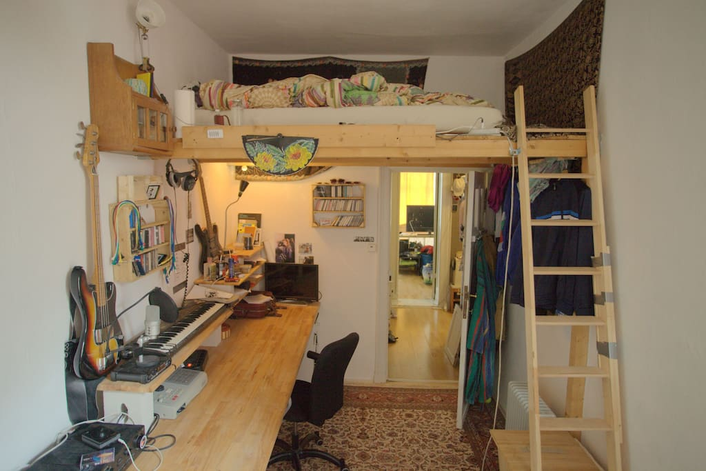 Bedroom with loft bed and large desk