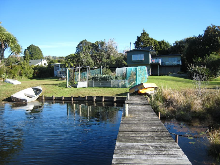 Our house with jetty, large vege garden and lawn. Your accommodation is on the lower level.