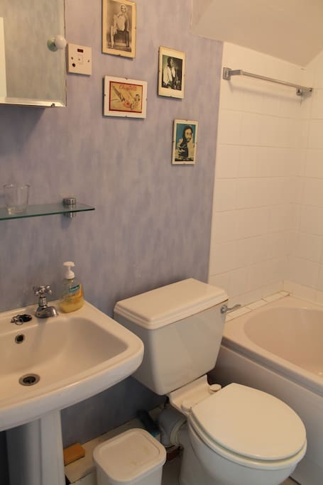 private ensuite bathroom with bath and shower unit