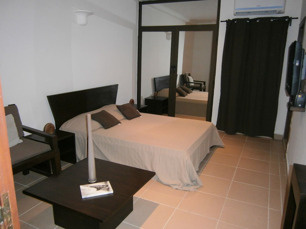 Spacious rooms with minimalist designed furnitures  made in the finest wood from Benin