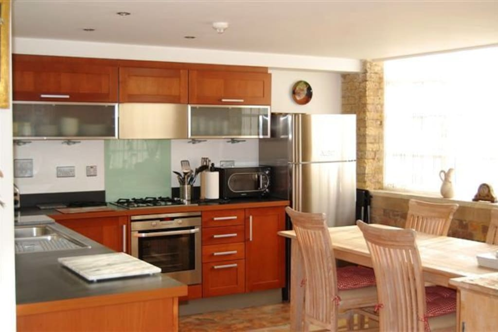 Kitchen and Dining Area - Well Appointed with Large Refridgerator/Freezer