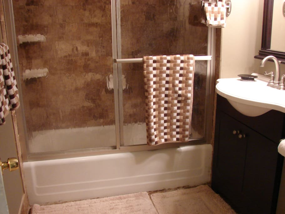 Upstairs Bathroom has heated tile floor and tiled bath tub