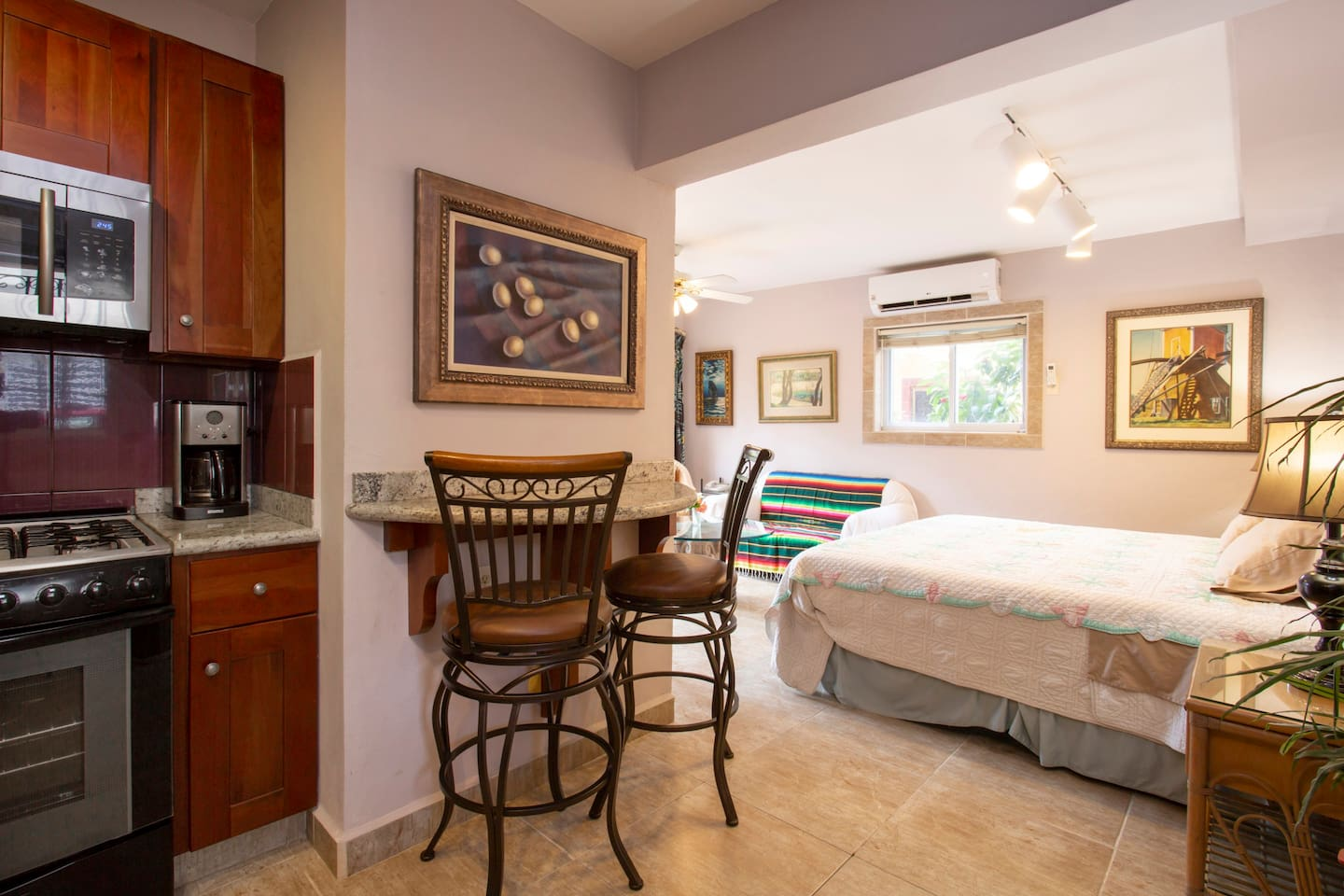 """This unit is first floor poolside. It is       Square feet and is a """"studio"""". There is no doored bedroom. The photo is from the front door entrance."""