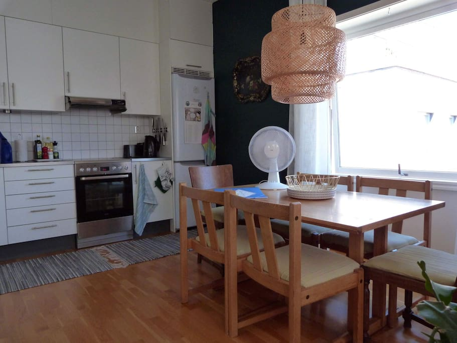 Modern kitchen and table with seating for 6 people