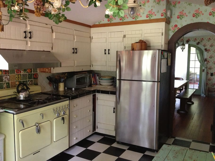 Charming cottage kitchen with all the necessities for dining in...or,