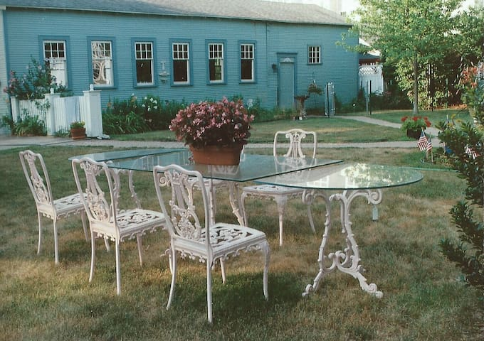 Back yard furniture for your morning coffee, picnic, or afternoon conversation.