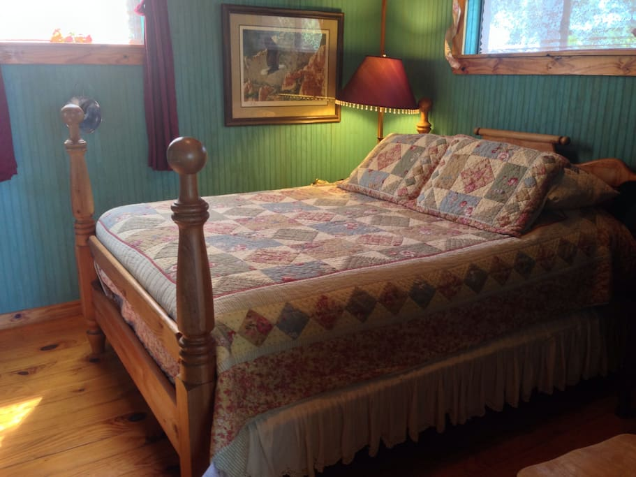 Queen bed with Comfe sheets.