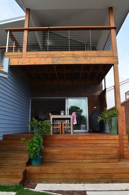 Large back deck on lower and upper floors with sweeping views of backyard, pool and upstairs, the city