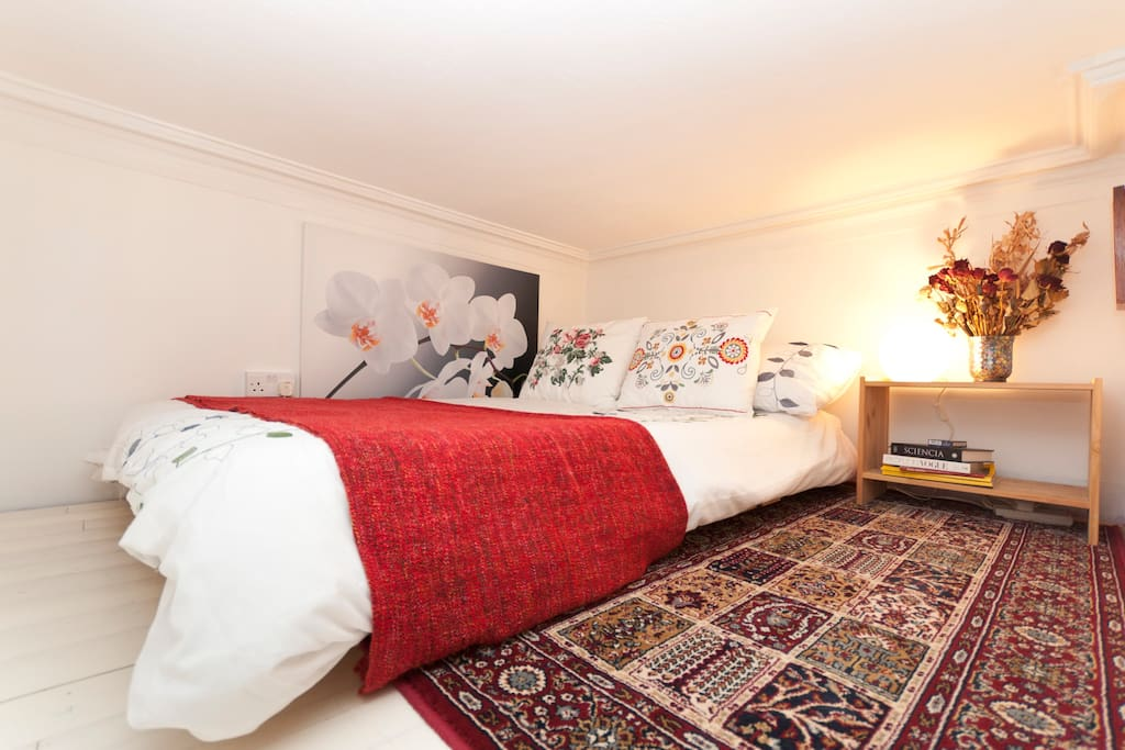 The view at the top of the ladder in your private room: a real mattress on a futon base, a very cosy platform bed!