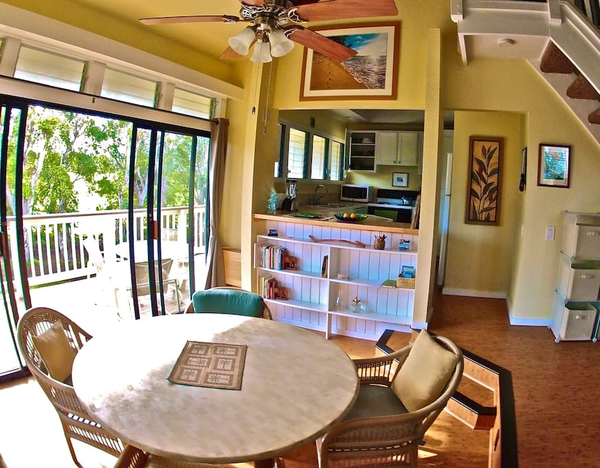 Wide angel lens perspective of the kitchen and dining.