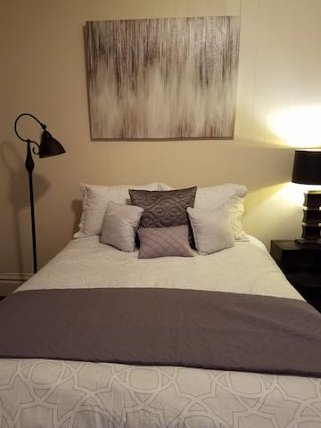 Bedroom #2, large bedroom, high ceilings, super comfortable memory foam king size bed, dresser, night table, lamps, full length mirror, room darkening blinds and curtains, walk in closet. Smoke and carbon monoxide detector.