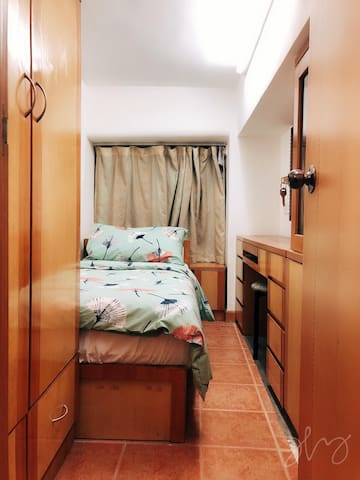 It is a room with a 80x180 cm bed, a desk, a wardrobe with a mirror and another wardrobe behind the door.