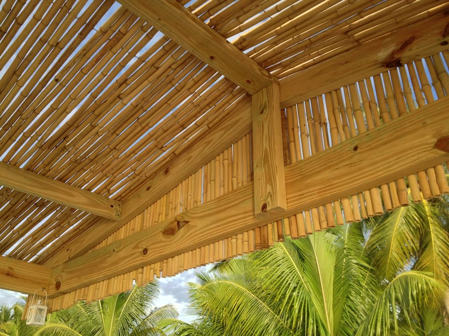 A bamboo roof over the dining area on the upper deck