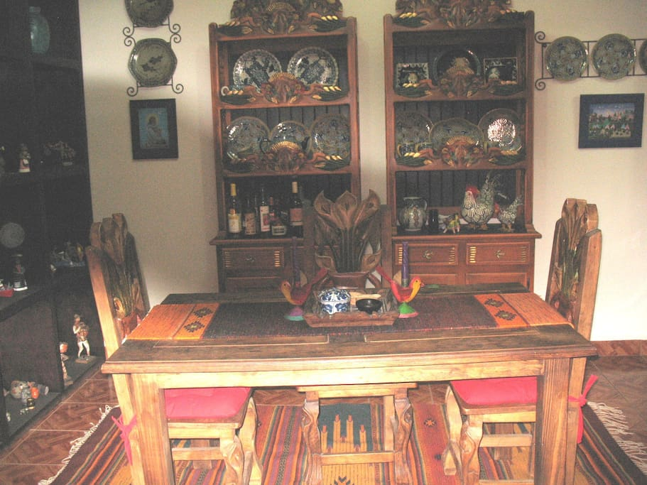 A comfortble dining area full of Mexican folk Art and furniture made in Michoacan,MX