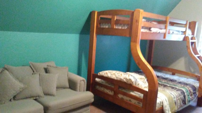 Bunk bed and couch in kids' room.