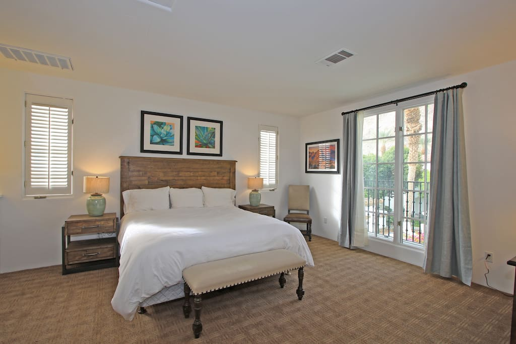 King bed and french doors to private balcony
