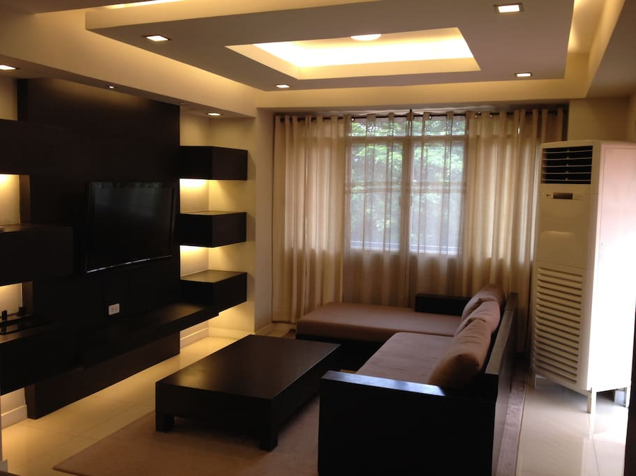 Interior Designed Living Area, with a 42inch flat screen TV and a 2 Ton air conditioner to keep you cool in the Heat!