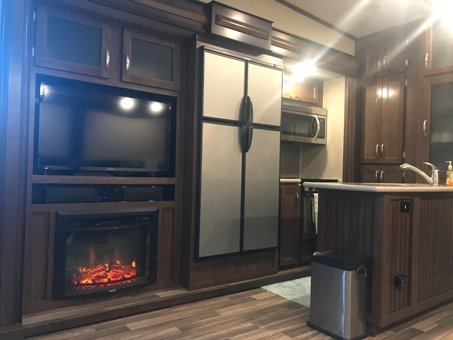 In the living are- full mini-kitchen, tv, dvd player, fire place, ambient lighting, leather seats & dining set for 4! Click the pic and see...