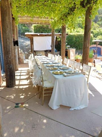 Dinner table setup on pool-side patio