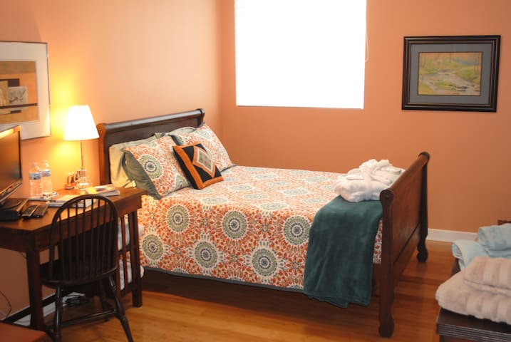 Bed with desk, table, dresser