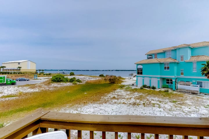 Beautiful coastal home w/ a community outdoor pool, dock, & beach access