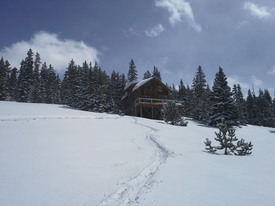 The ski runs behind the cabin were once part of the Climax ski area, which closed in 1963.
