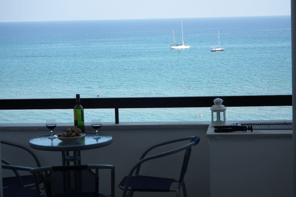 The balcony overlooks the sea