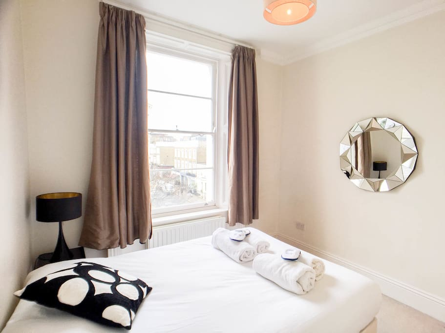 Beautiful and bright bedroom with comfortable double bed