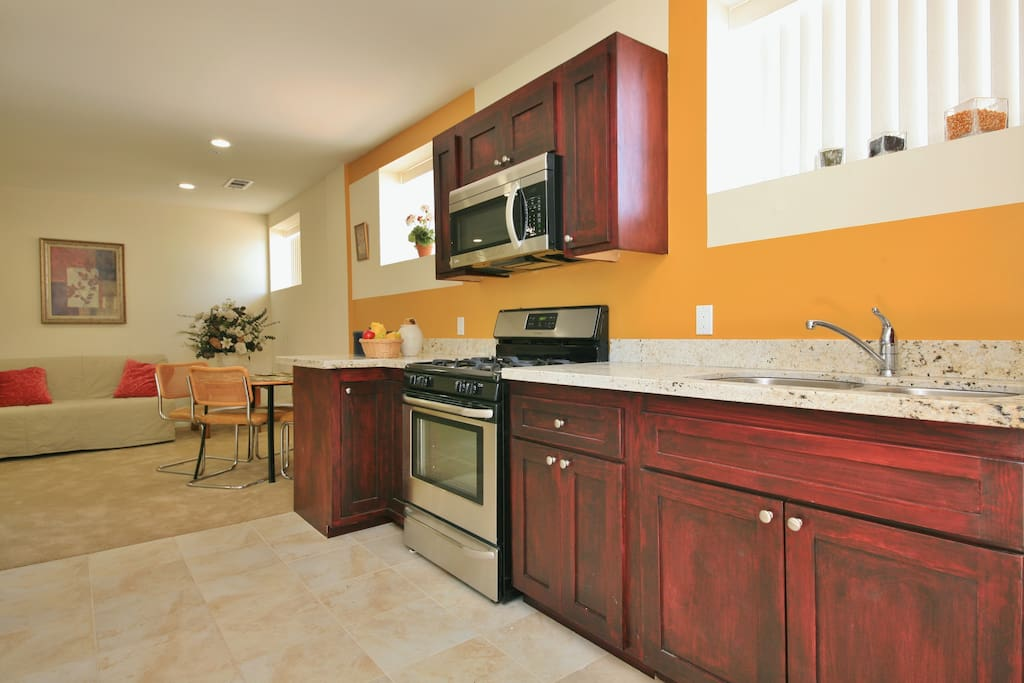 This kitchen is fully appointed and waiting for you.