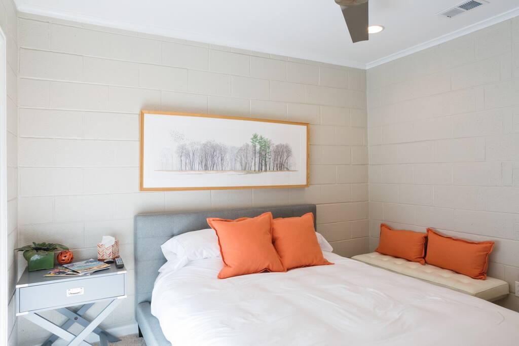 The Casita bedroom with sun shining through the sliding glass door.