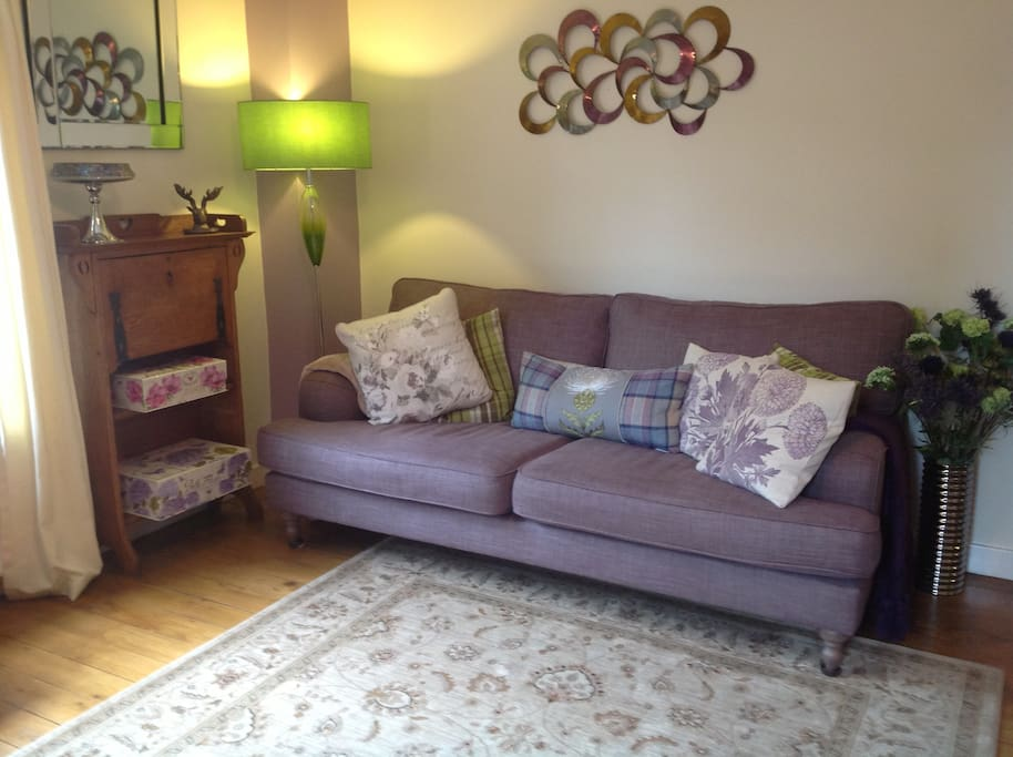 beautiful, comfortable sofa in tastefully decorated living room