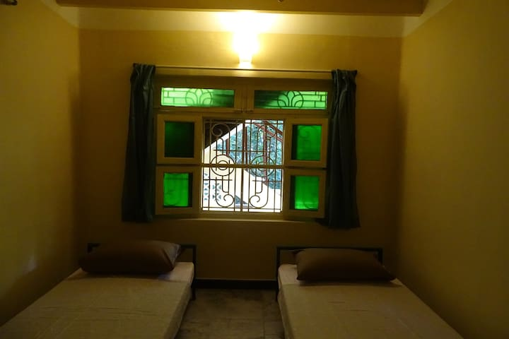 Single Bed With Fan in Shared Room of Pondicherry