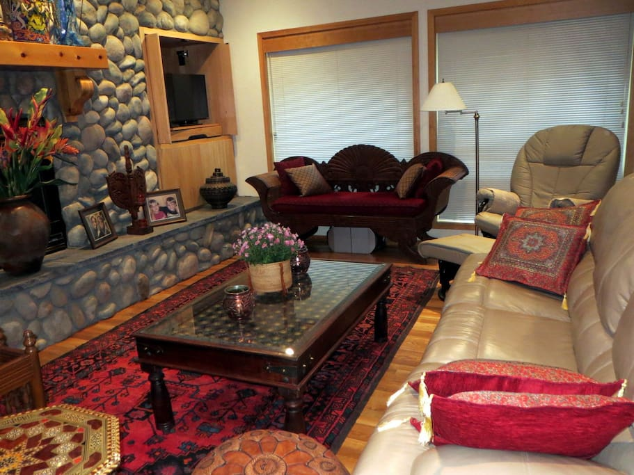 Living room with couch that has a queen size hide-a-bed.