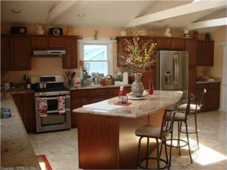 Stunning Kitchen all new updated appliances, cabinets, granite counter-tops and beautiful beamed and skylight ceiling